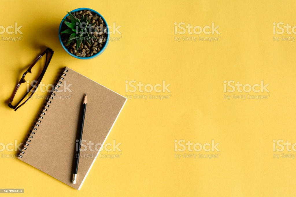 notebook and pencil on yellow desk royalty-free stock photo