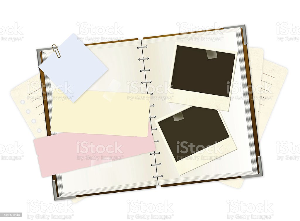 Notebook and photos royalty-free stock photo
