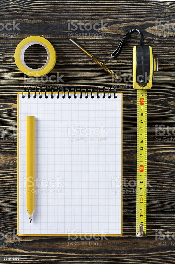 Notebook and technical tools on the table royalty-free stock photo