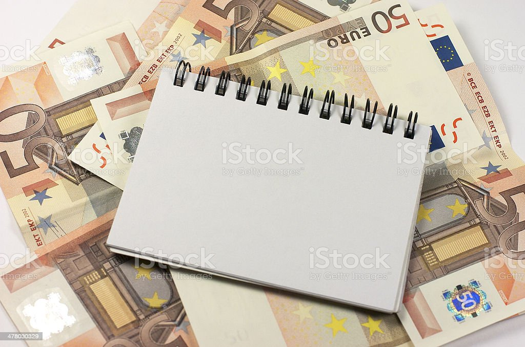Notebook. Banknotes royalty-free stock photo