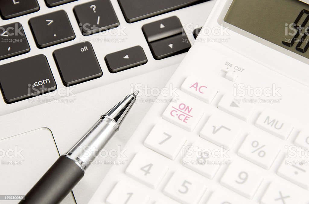 notebook, calculator and pen royalty-free stock photo