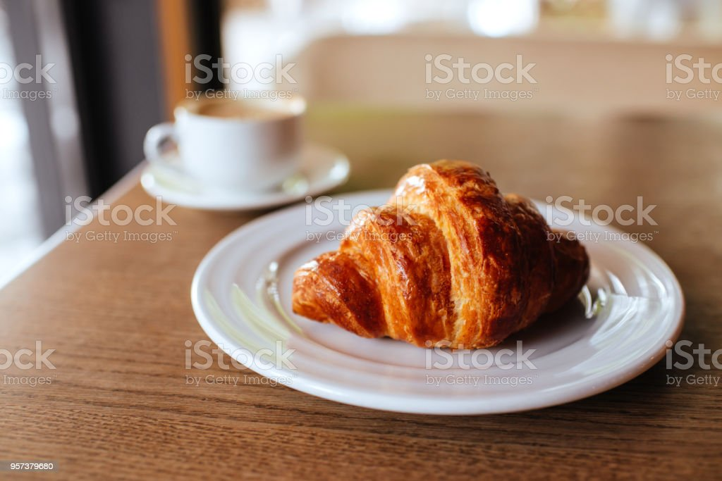 Notebook, cappuccino and croissant. stock photo