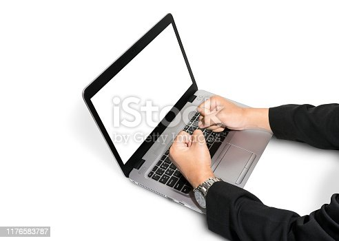 Notebook computer are smashed by Businessman hands wearing black suits isolated on white background. Clipping path include in this image.