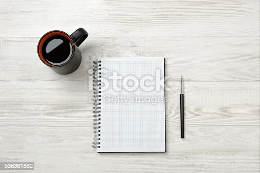 istock Notebook, cup of coffe and pencil put on table 538361862