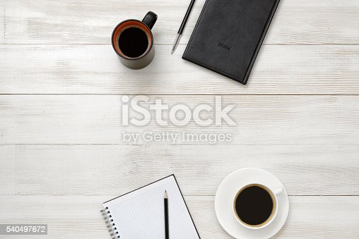 istock Notebook, cup of coffe and pencil put on table 540497672
