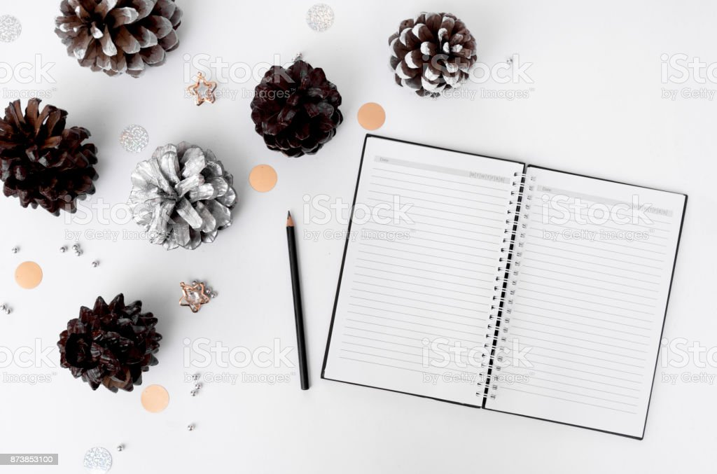 Notebook diary christmas mockup, pine cones and decorations on white background, flat lay top view. stock photo