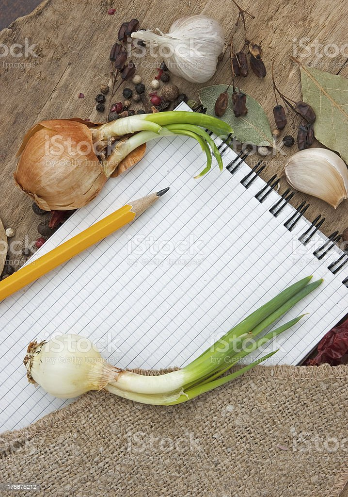 notebook for recipes on the background of spices royalty-free stock photo