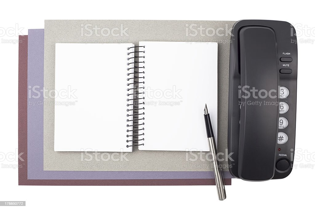 Notebook, fountain pen, and phone on textured  paper royalty-free stock photo