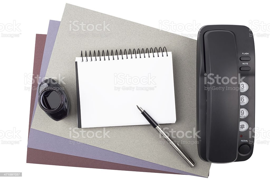 Notebook, fountain pen, ink and phone on textured  paper royalty-free stock photo