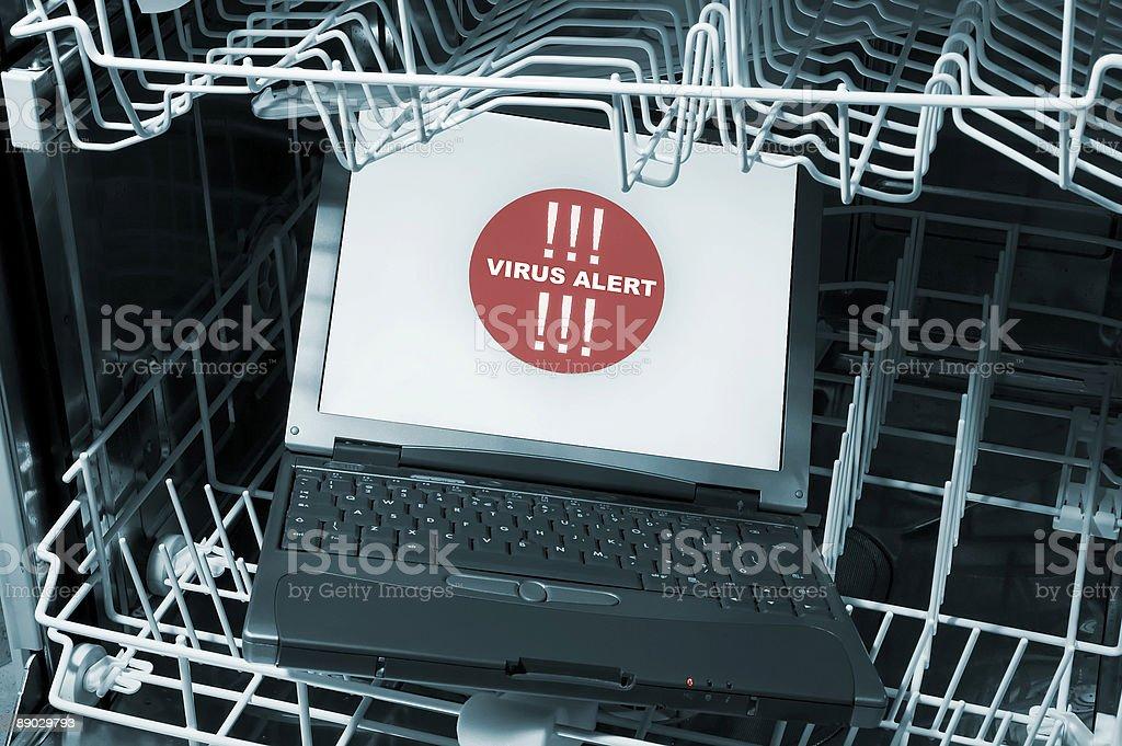 Notebook in dishwasher - virus alert royalty-free stock photo