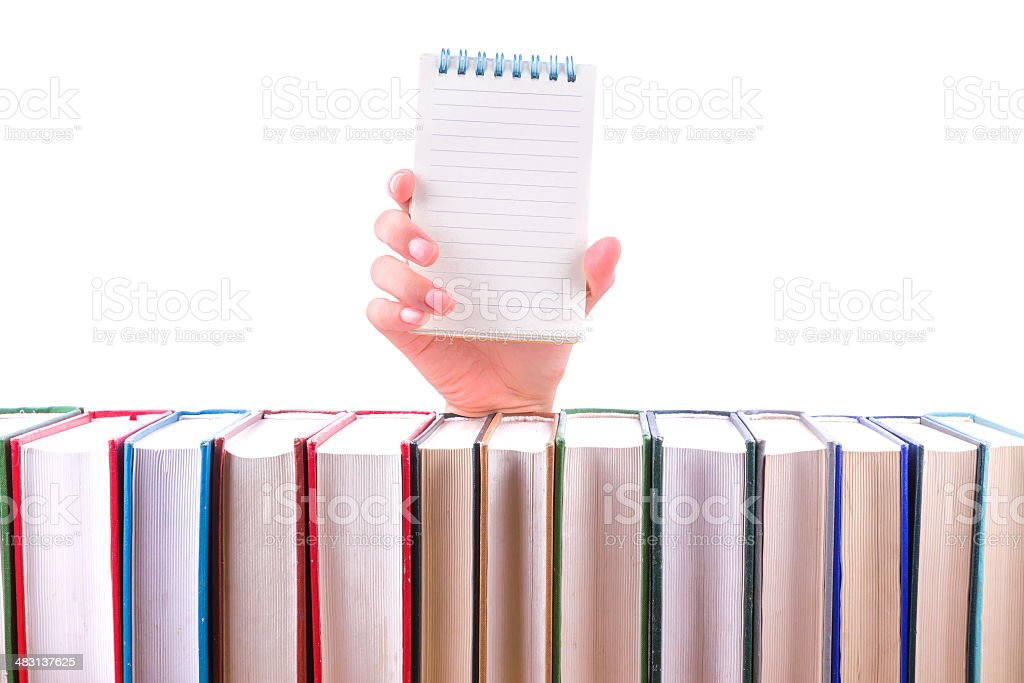 Notebook in Hand on book stack isolated royalty-free stock photo