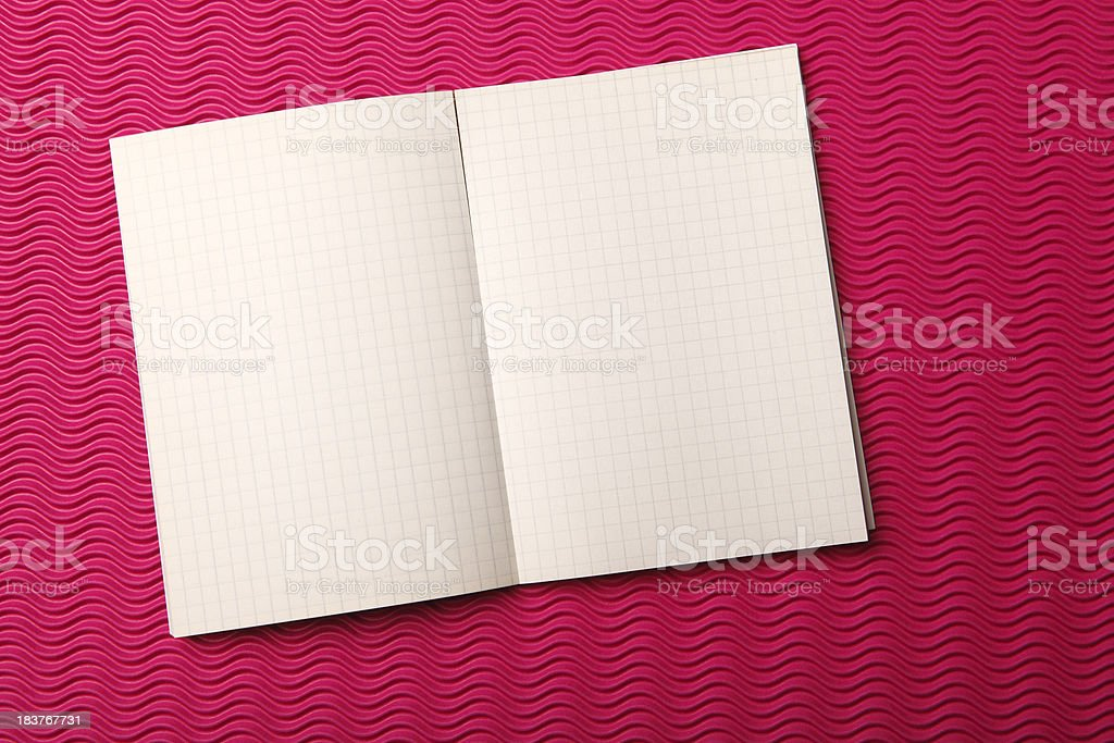 Notebook is in the rope on red abstract paper royalty-free stock photo