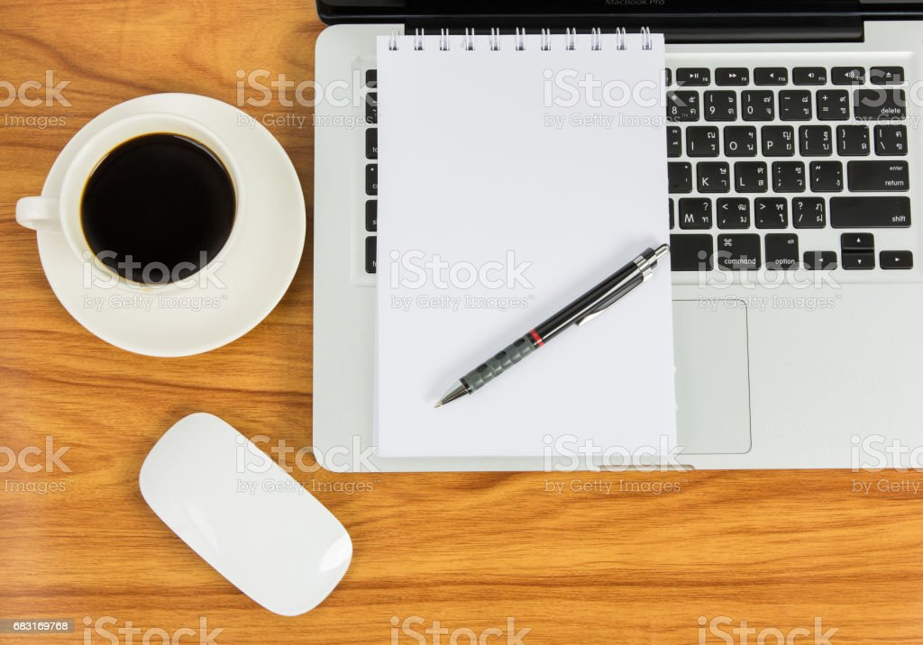 Notebook laptop and coffee cup royalty-free stock photo