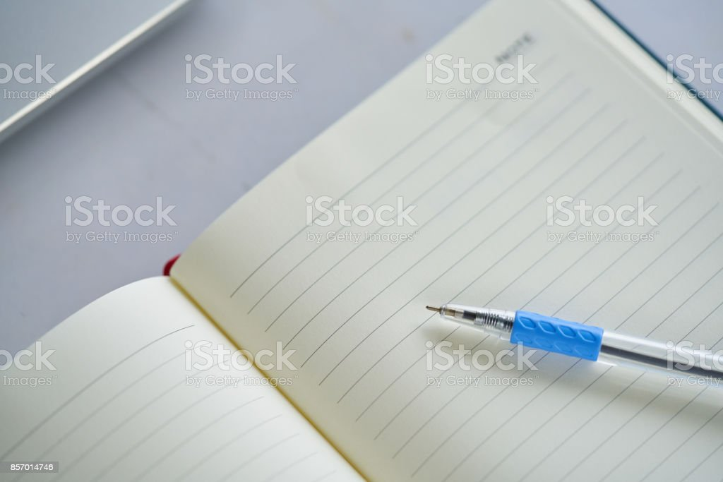 notebook ,notepad, writing pad, drawing pad or legal pad on the table