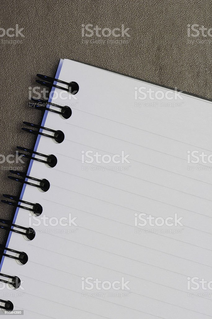 Notebook on Leather Textured Surface royalty-free stock photo