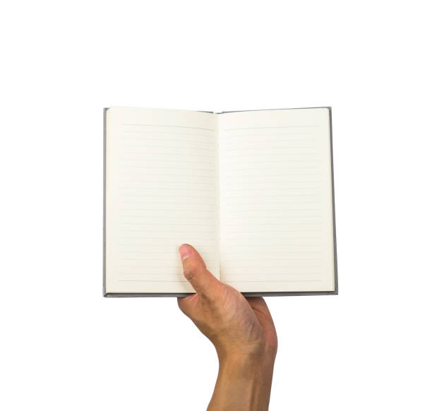 Notebook on one hand holding, with clipping path stock photo