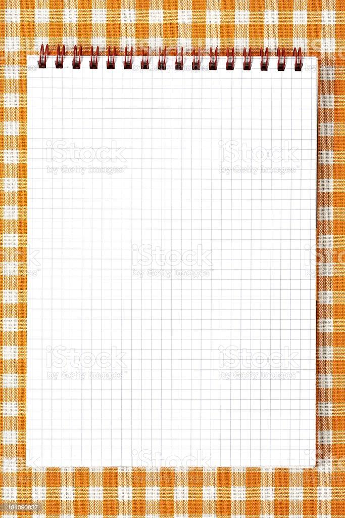 Notebook on orange tableclot royalty-free stock photo