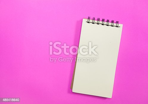 1139340462 istock photo notebook on pink background. 485418640