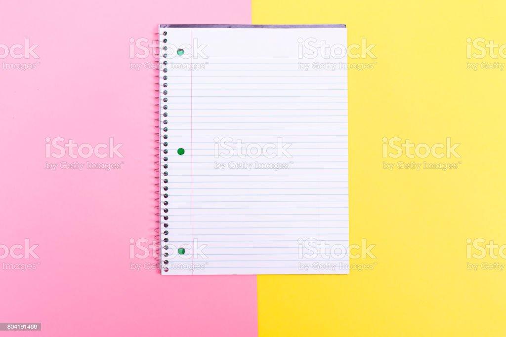 Notebook on split background stock photo