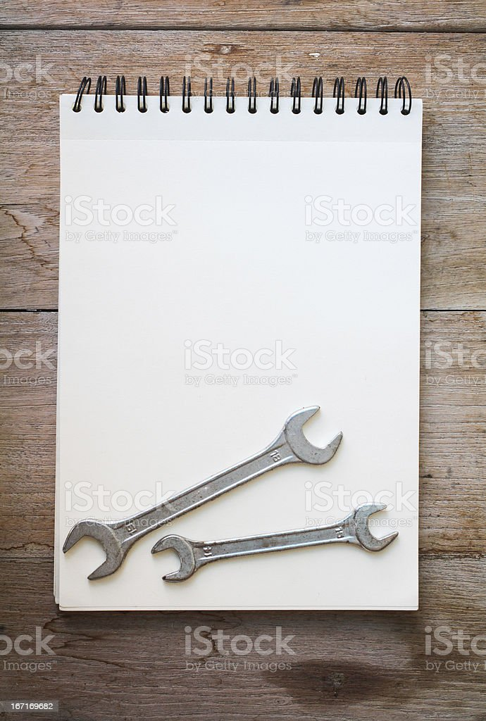 notebook on the wood background royalty-free stock photo