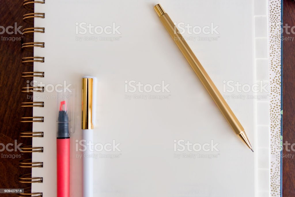 Notebook on Wooden Background Calendar Gold Pen and Pencil Highlighter Tabbed Room for Copy Text Space stock photo