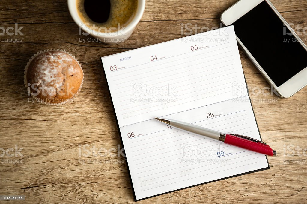 Notebook on wooden desk stock photo