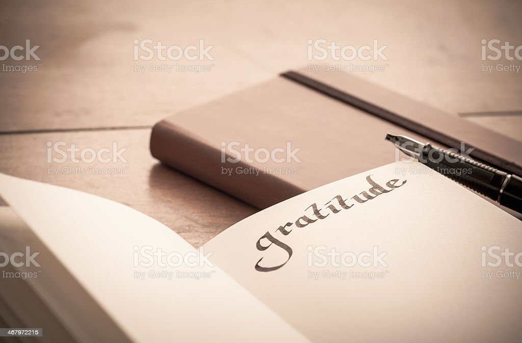 Notebook on Wooden Table - Gratitude Journal stock photo