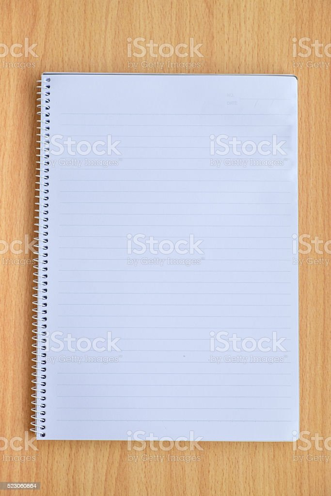 Notebook on wooden wall stock photo