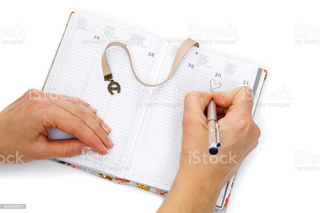 Notebook opened with female hands writing stock photo
