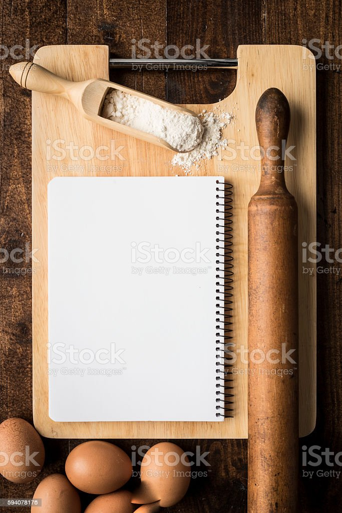Notebook over kitchen table White paper notebook over kitchen table ready for write. Copy space background for food and bakery Backgrounds Stock Photo