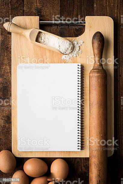 Notebook Over Kitchen Table Stock Photo - Download Image Now