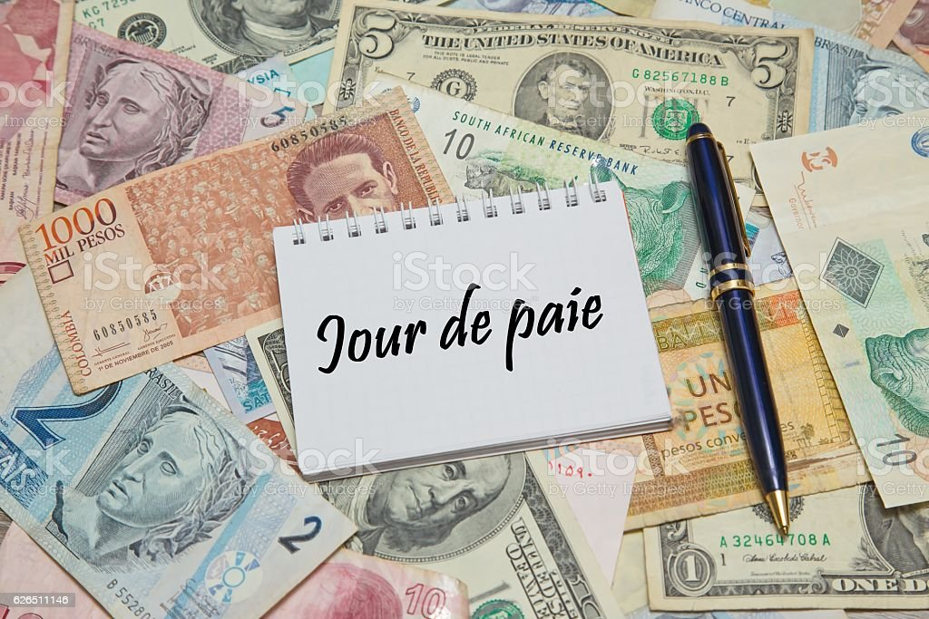 Notebook page with FRENCH text 'JOUR DE PAIE (PAYDAY) stock photo