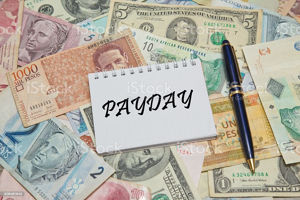 Notebook page with text PAYDAY stock photo