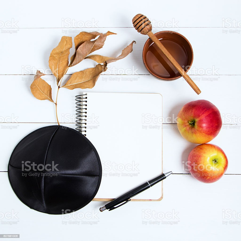 Notebook, pen and black kipa on a white wooden background stock photo