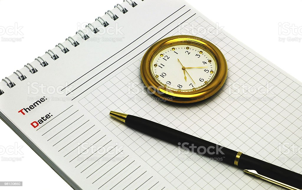 Notebook, pen and clock royalty-free stock photo