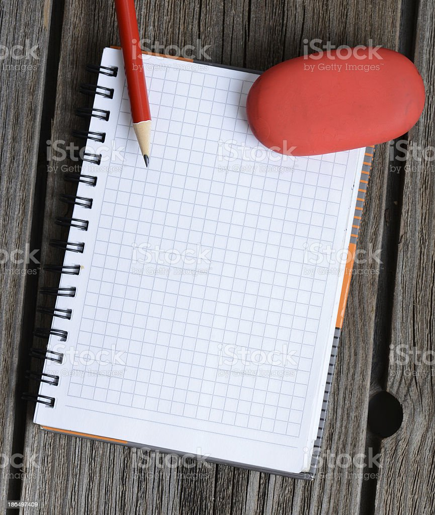 notebook, pencil and eraser royalty-free stock photo