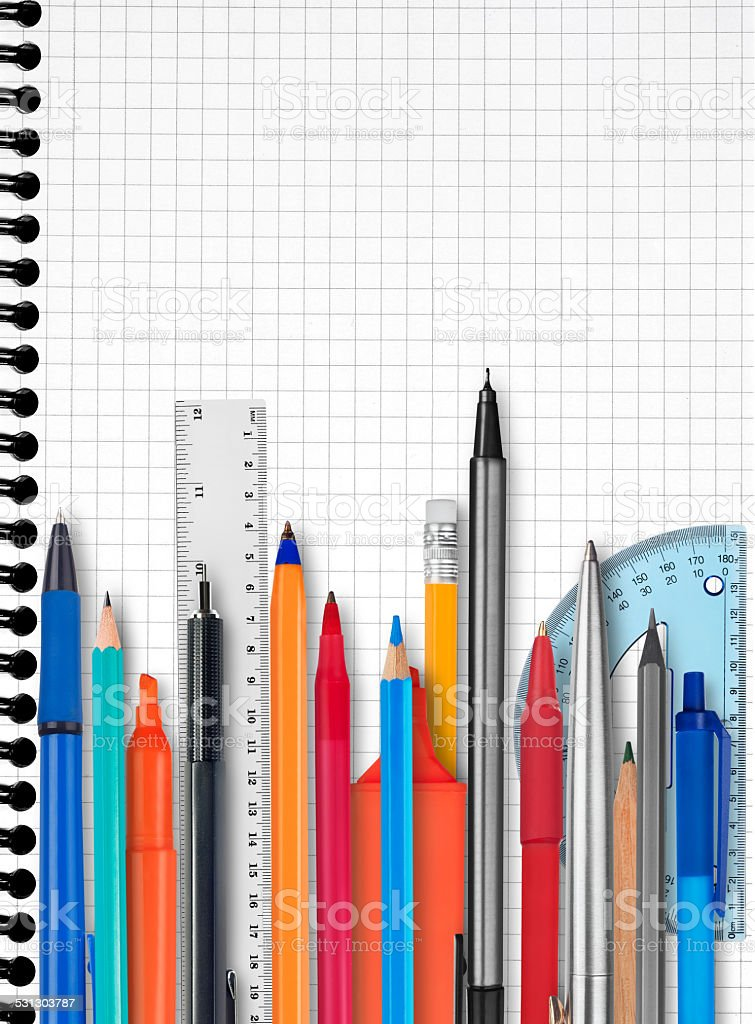 Notebook, pens and pencils stock photo