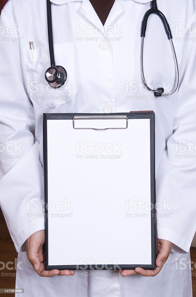 doctor is holding a notebook.