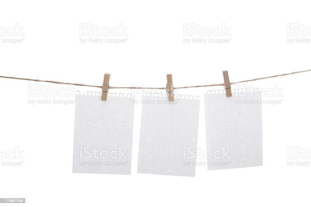 Notebook sheets and clothespins royalty-free stock photo