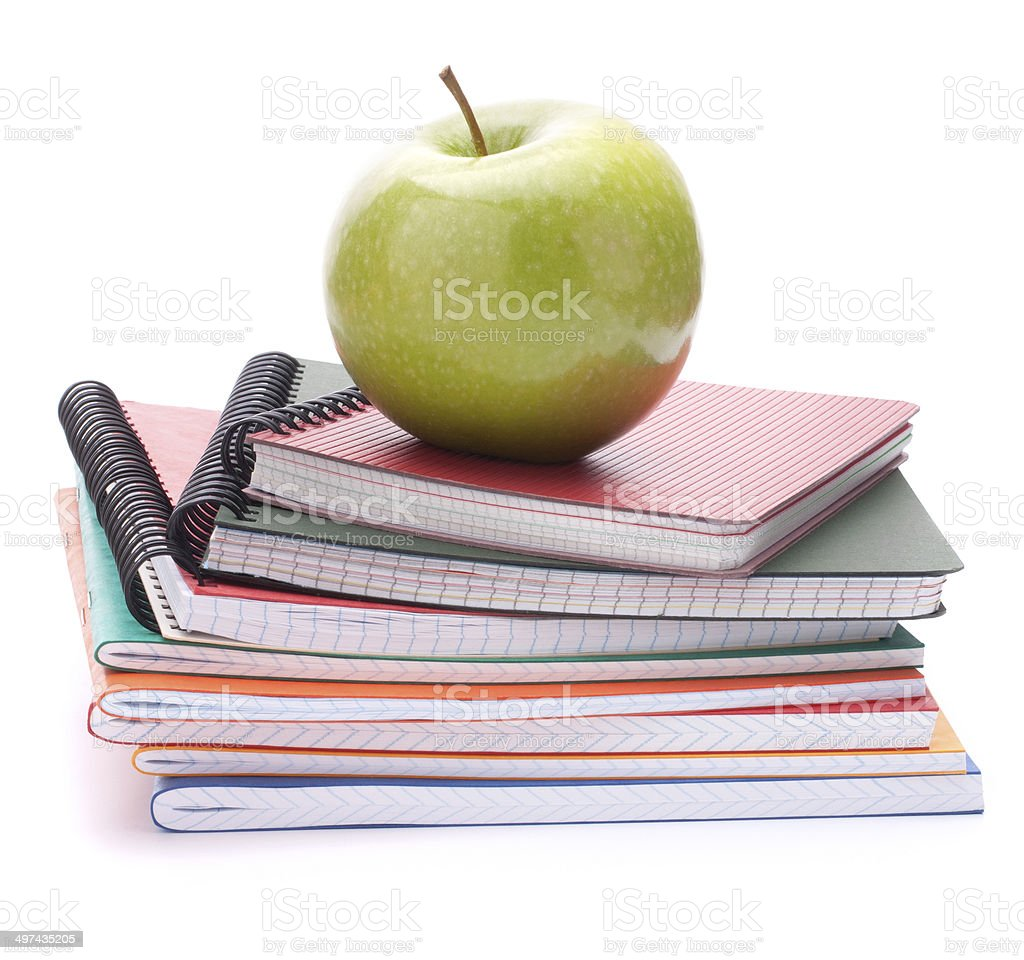 Notebook stack and apple. Schoolchild and student studies accessories stock photo
