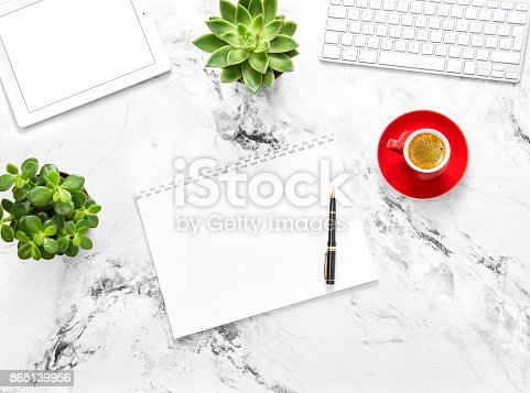 Notebook, tablet pc, coffee, succulent plants on marble background. Working desk. Flat lay