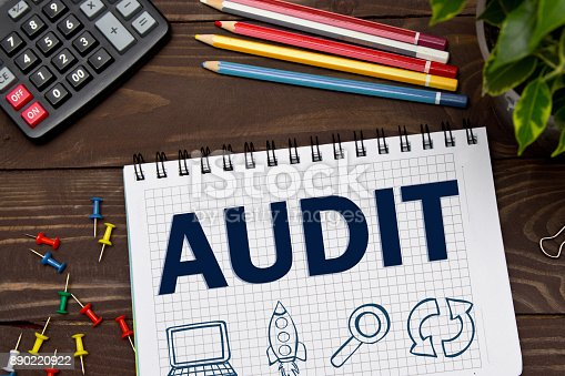 istock Notebook with a Business notes AUDIT on the office table with tools. Concept AUDIT with elements of infographics. 890220922