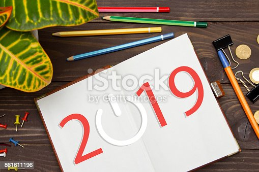 istock Notebook with a notes 2019 on the office table with tools. Business innovation,business vision , webinar, launch in 2019 . 861611196