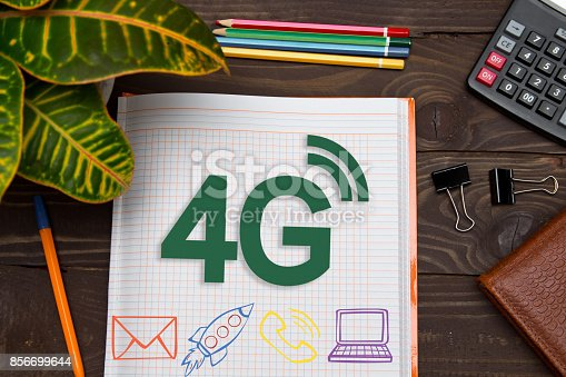 istock Notebook with a notes 4G on the office table with tools. Concept with elements of infographics. 856699644