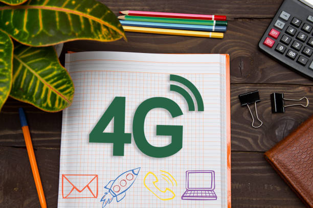 notebook with a notes 4g on the office table with tools. concept with elements of infographics. - 4g foto e immagini stock