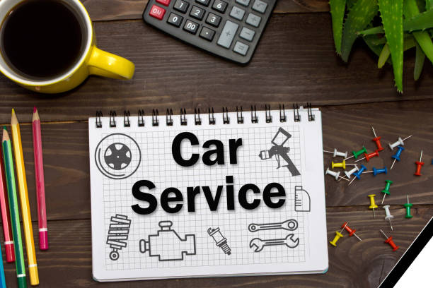 Notebook with a notes Car Service on the office table with tools. Concept with elements of infographics. stock photo