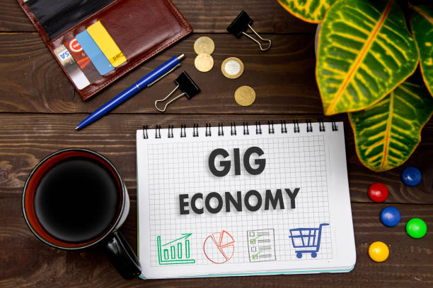 notebook with a notes gig economy on the office table with tools. concept with elements of infographics. - popular music concert stock photos and pictures