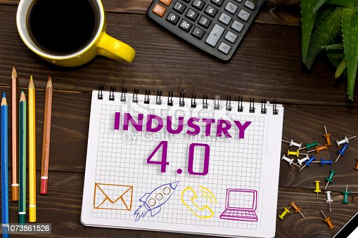 973144806 istock photo Notebook with a notes INDUSTRY 4.0 on the office table with tools. Concept with elements of infographics. 1073861526