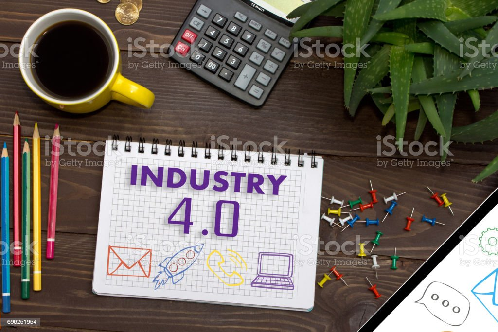 Notebook with a notes INDUSTRY 4.0 on the office table with tools. Concept with elements of infographics. - Foto stock royalty-free di Affari