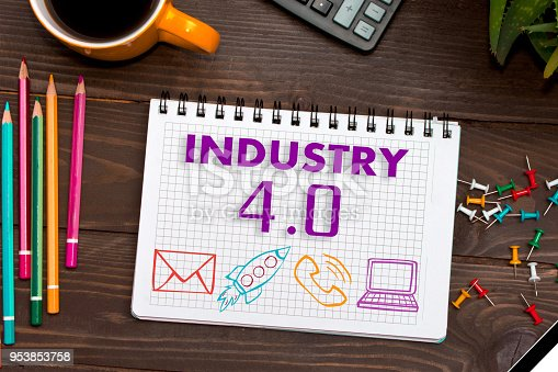 1167121815 istock photo Notebook with a notes INDUSTRY 4.0 on the office table with tools. Concept with elements of infographics. 953853758
